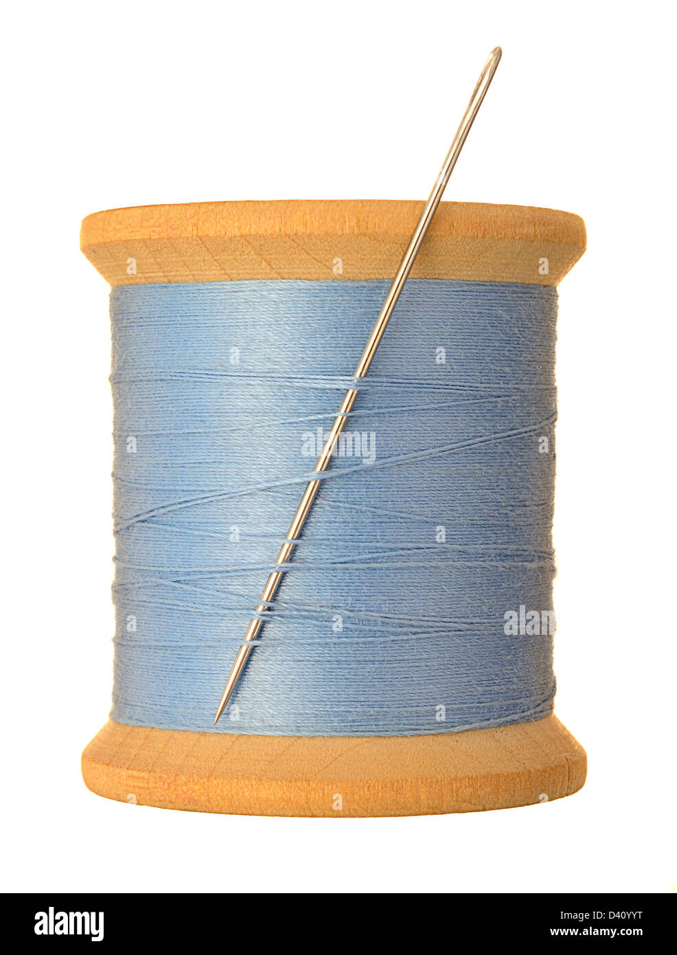 needle and thread - spool of blue thread and sewing needle - Stock Image