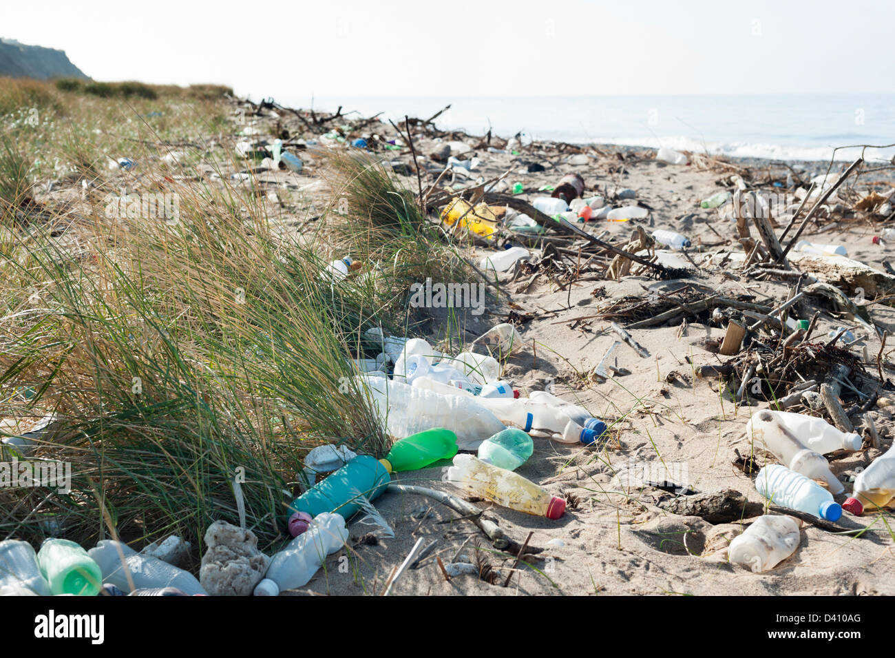 Plastic bottles and other rubbish and waste washed up on a dirty British beach - Stock Image