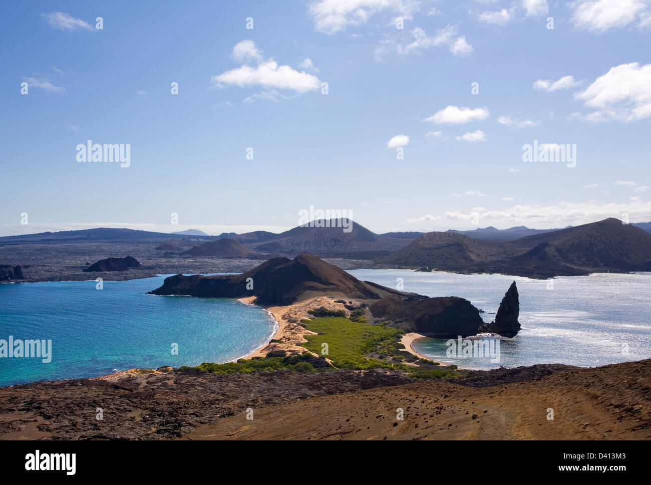 Ecuador, Galápagos Islands, Isla Bartolomé, view of the islands lava landscape towards neighboring Isla - Stock Image