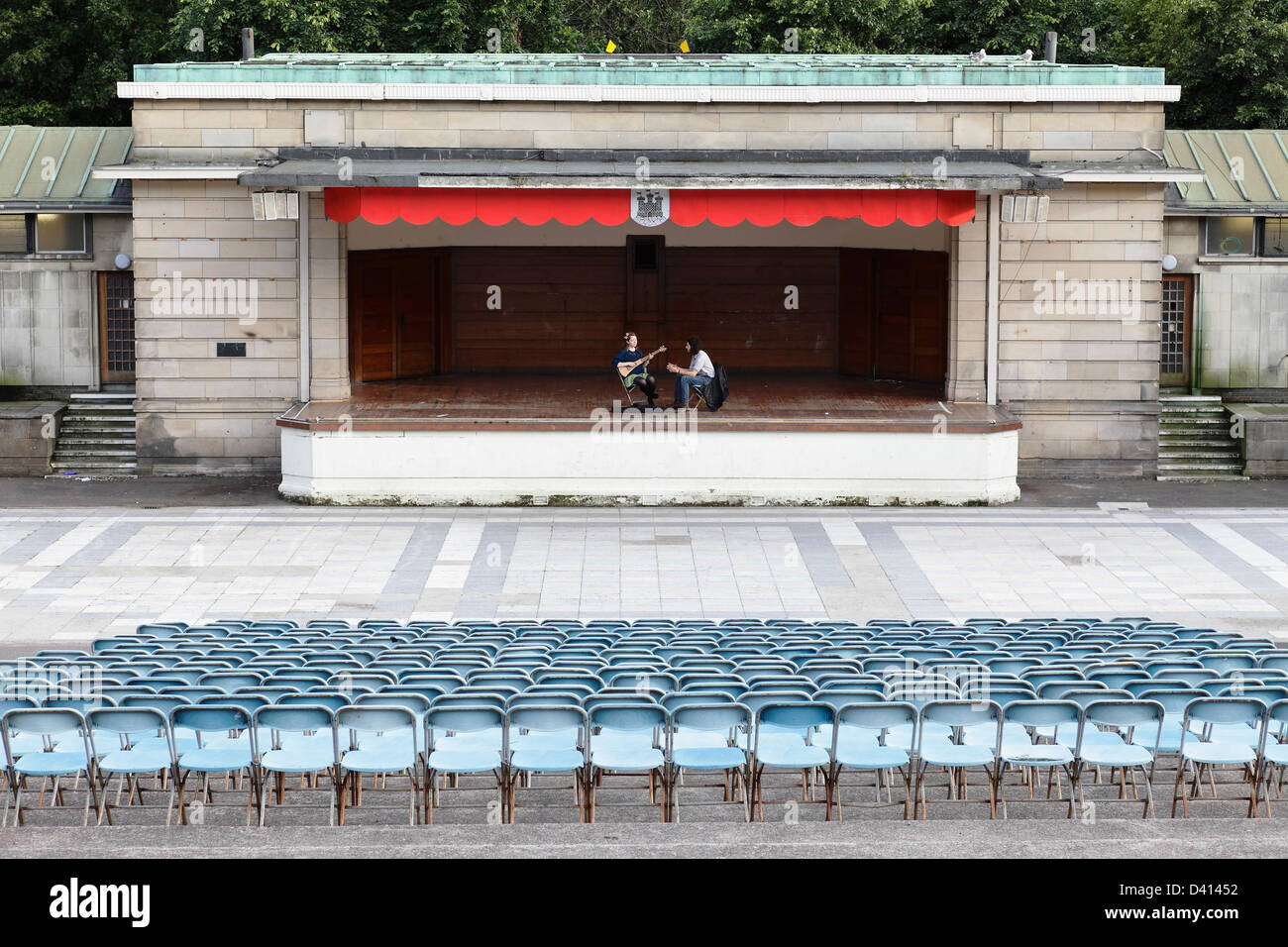 Musicians practicing on the stage of the Ross Bandstand in West Princes Street Gardens in Edinburgh city centre, - Stock Image