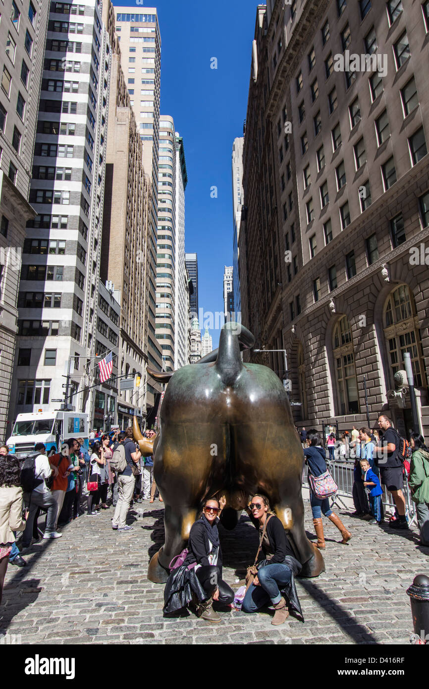 Tourists at The bull of Wall Street, Financial district, New York City, USA  Stock Photo