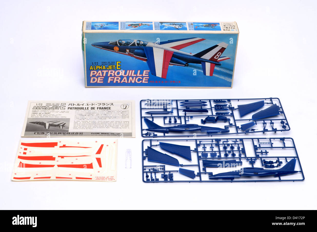 Fujimi 1/72 scale Alpha Jet model aircraft construction kit box and parts on white background - Stock Image