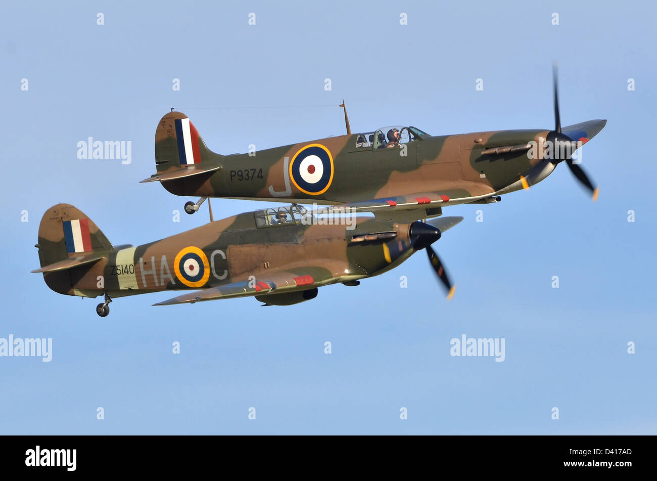 Spitfire 1A plane & Hurricane Mk. XIIA plane in RAF Battle of Britain 1940 camouflage displaying at Duxford - Stock Image
