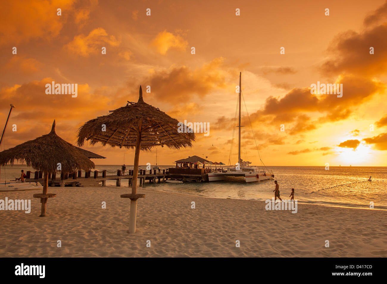 Aruba Palm Beach sunset West Indies Dutch Carribean Central America ABC Catamaran - Stock Image
