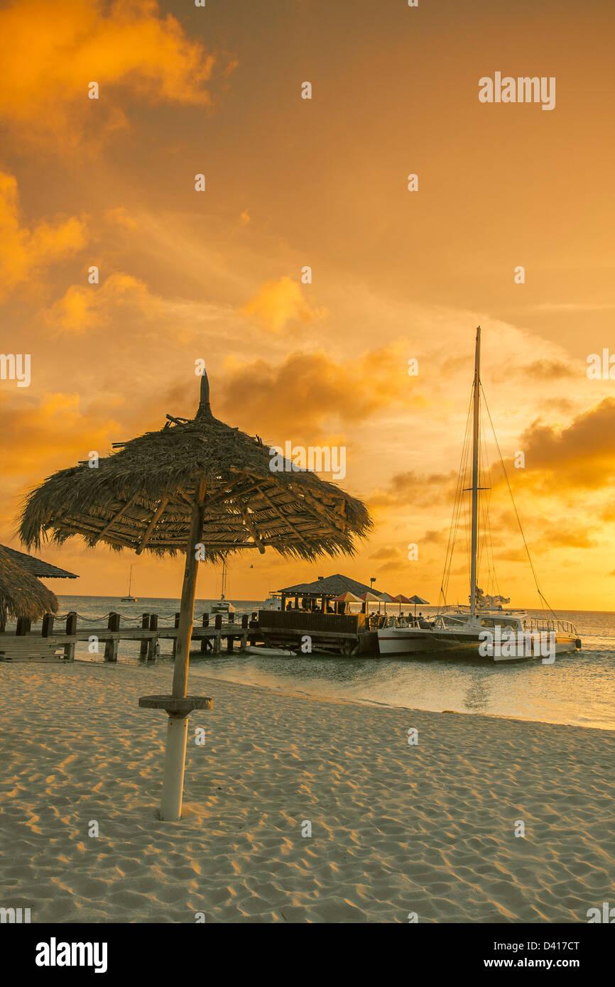 Aruba Palm Beach sunset West Indies Dutch Carribean Central America ABC Catamaran - Stock Image
