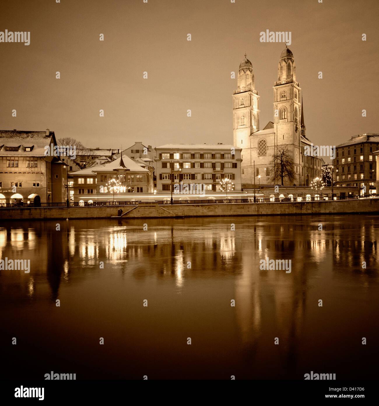 Grossmunster at river Limmat. , Limmatquai, twilight, Zurich - Stock Image