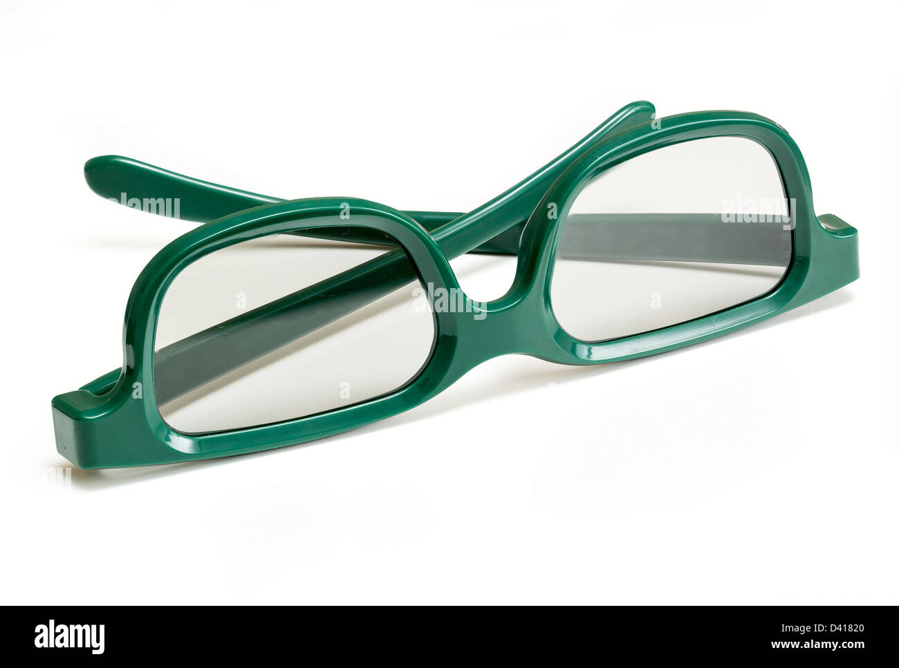 Pair of green 3d polarized glasses for watching 3-d movies in cinema isolated against white - Stock Image