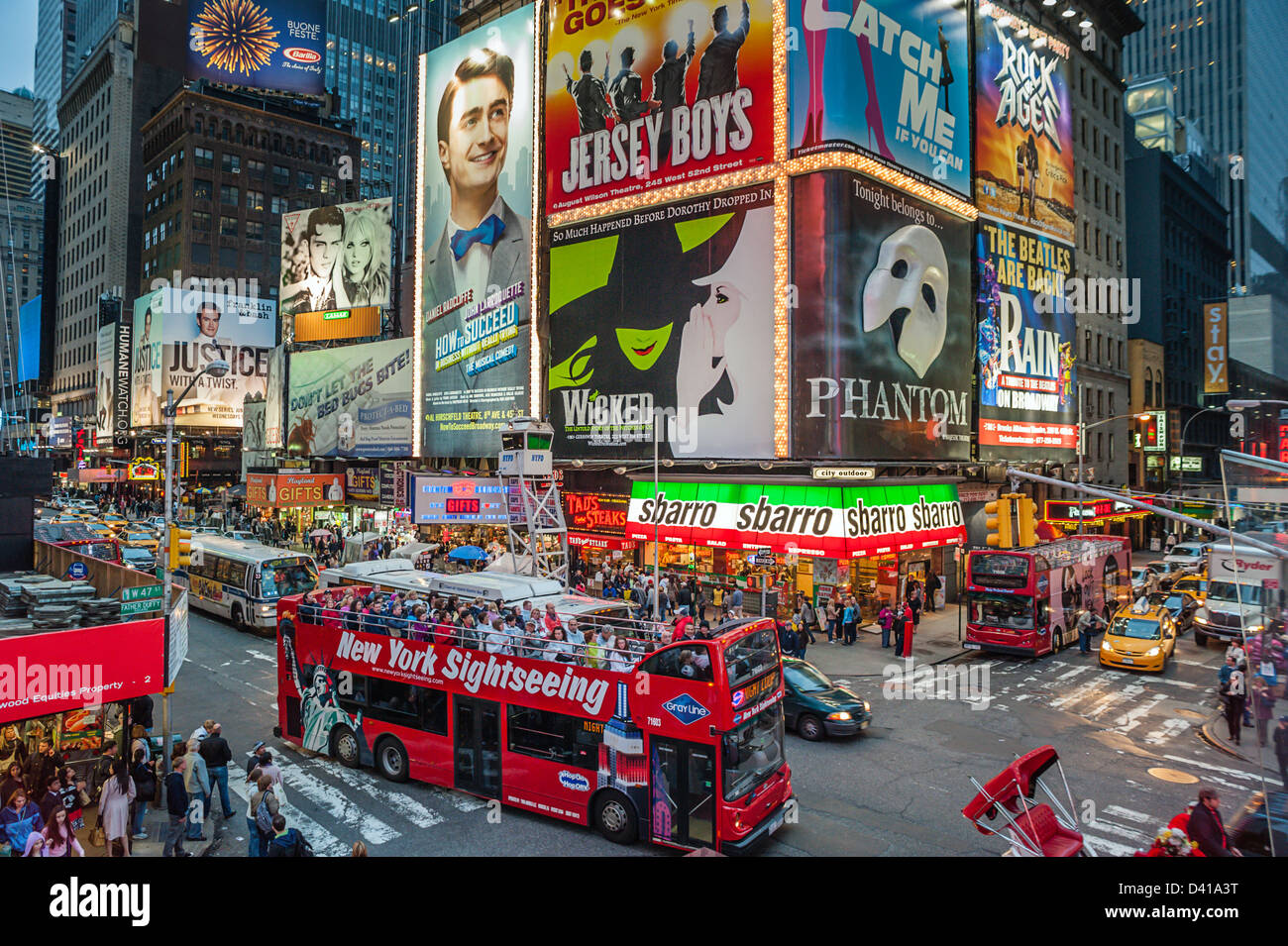 A sightseeing bus packed with tourists in Times Square New York City - Stock Image