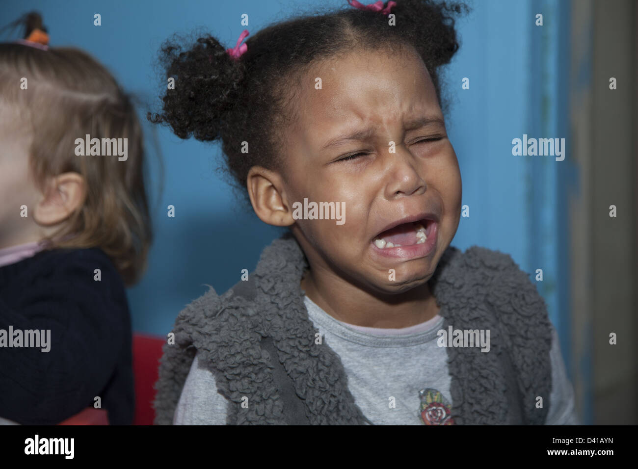 Upset child at a multicultural nursery school and early learning center in Brooklyn, NY. - Stock Image
