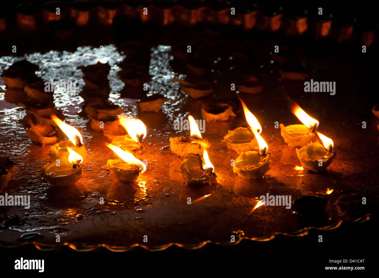 Lit oil lamps made of lemon - Stock Image