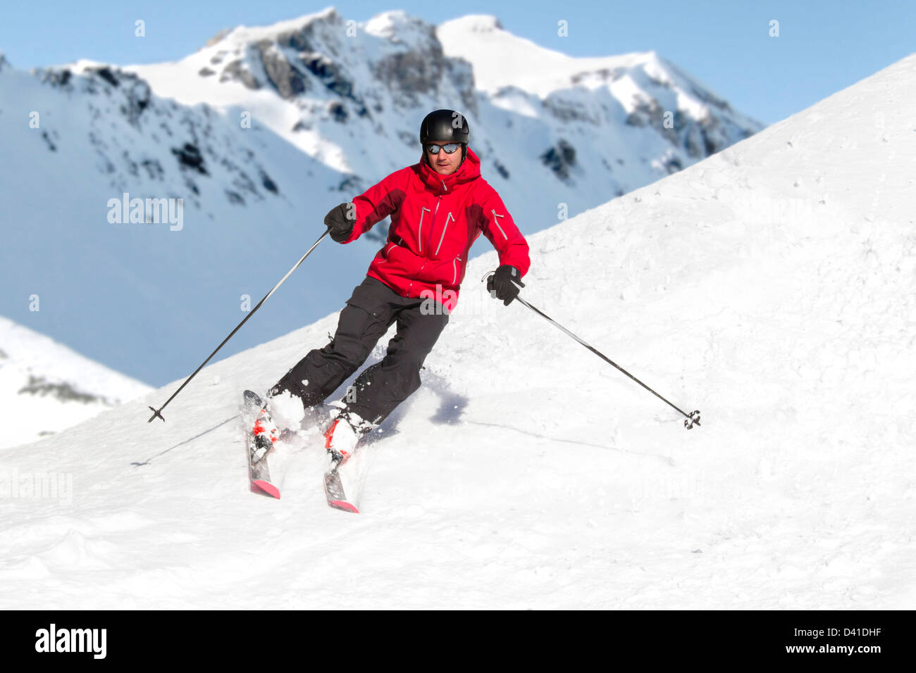 Man is skiing in the alps - Stock Image