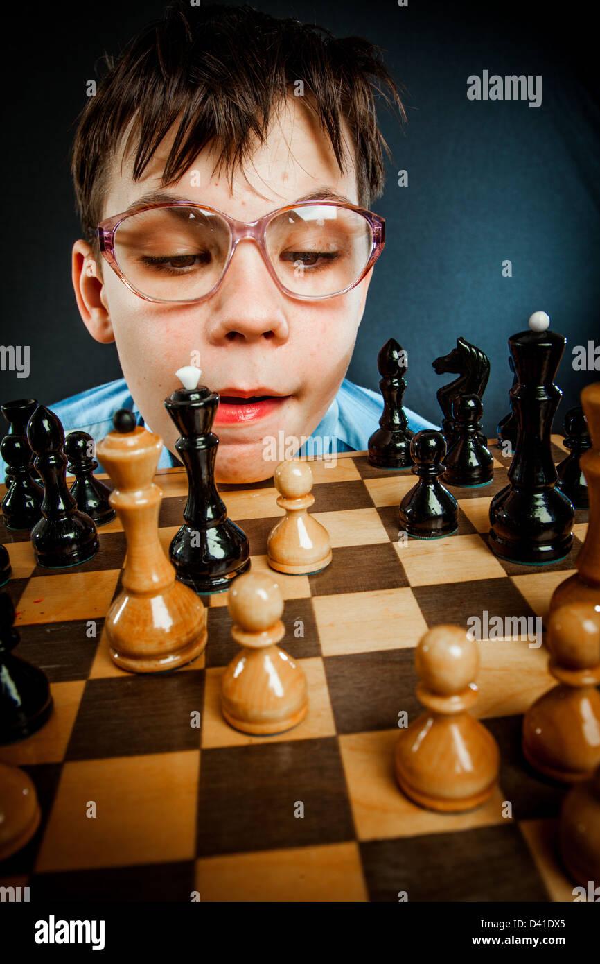 wunderkind play chess. Nerd boy. - Stock Image