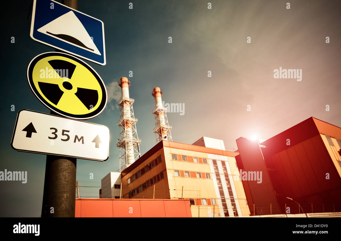 Nuclear Power Plant with Radioactivity Sign - Stock Image