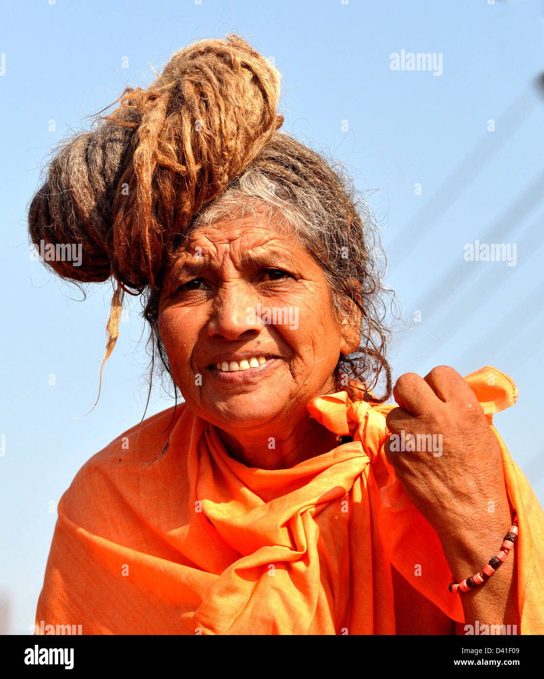 Female Sadhu (Hindu Holywoman) arrive to take Shahi Snan (royal bath) at the bank of Sangam confluence of river Stock Photo