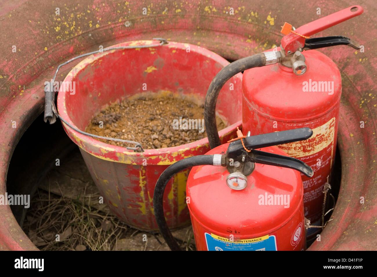 fire extinguishers sand bucket extinguisher emergency fires Stock Photo