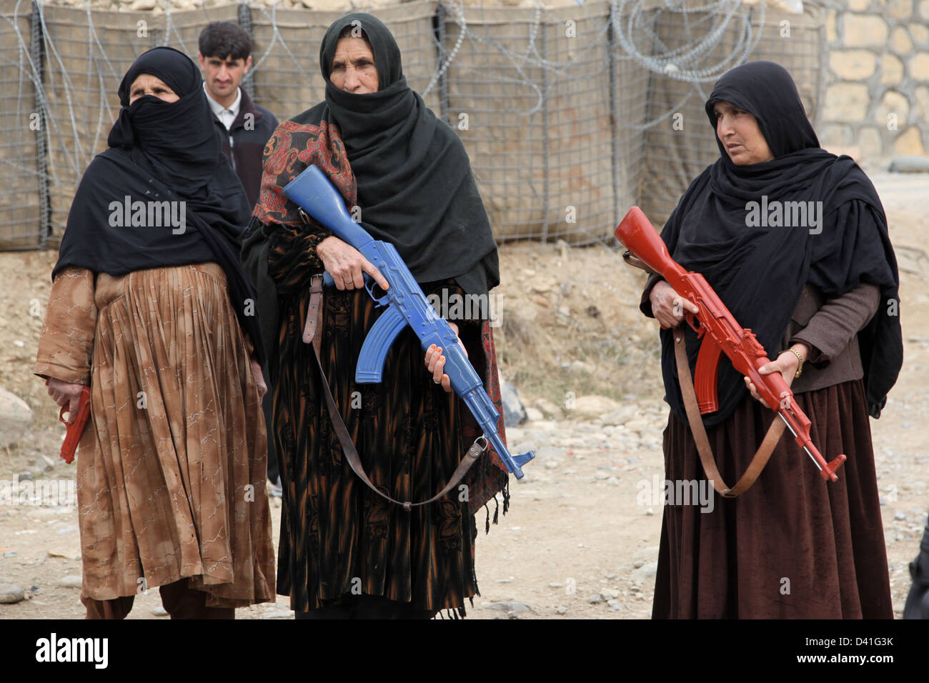 Women Afghan Uniform Police wield dummy training weapons while conducting a training exercise February 25, 2013 - Stock Image