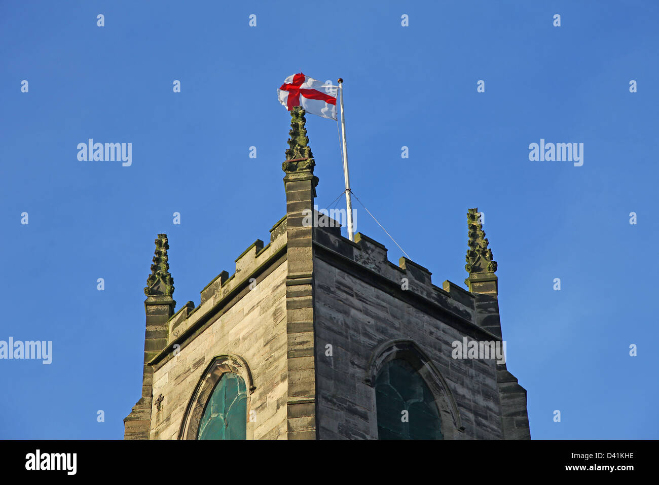Flag of St George on a flagpole at St Giles the Abbot parish church in Cheadle Staffs Staffordshire England UK - Stock Image