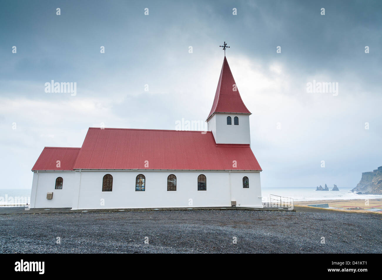 The church at Vik Icleand on an overcast day with moody sky and muted colours - Stock Image