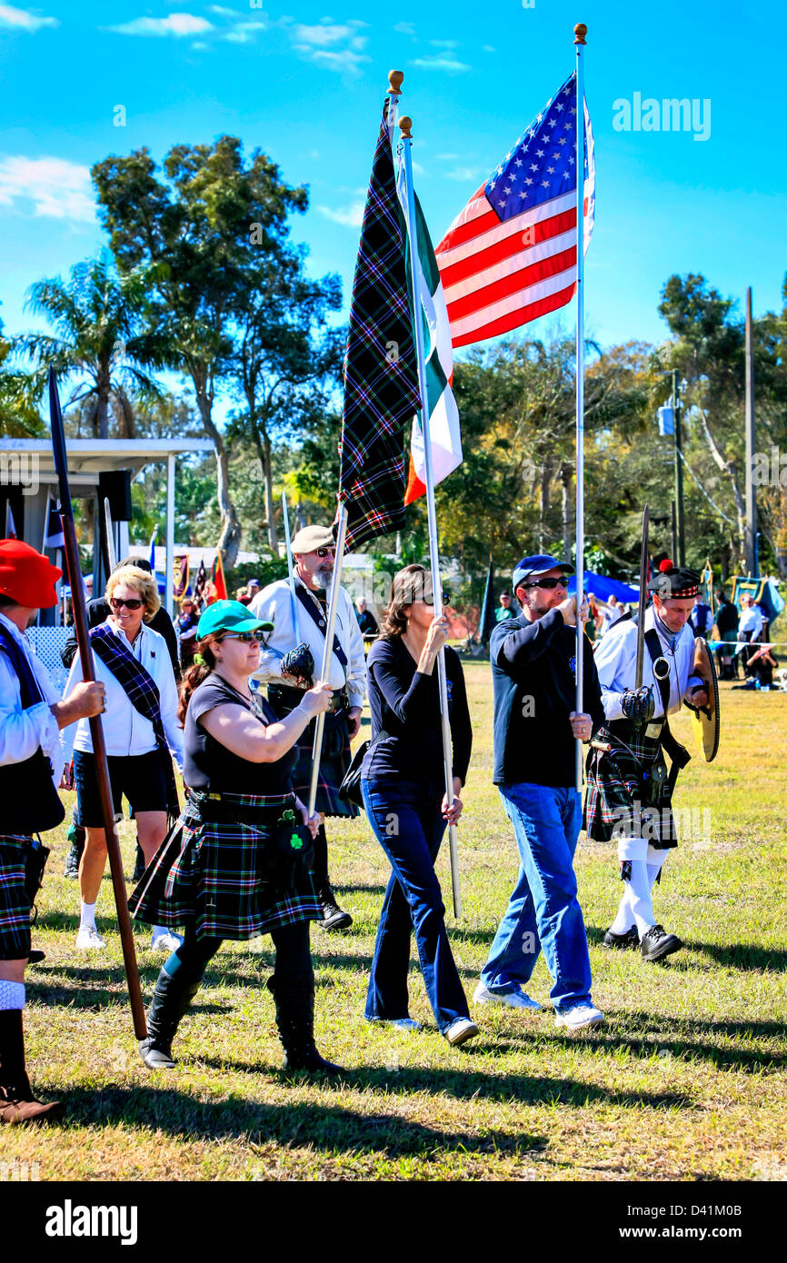 American-Scottish clans men & women march around the arena at the Sarasota Highland Games. Stock Photo
