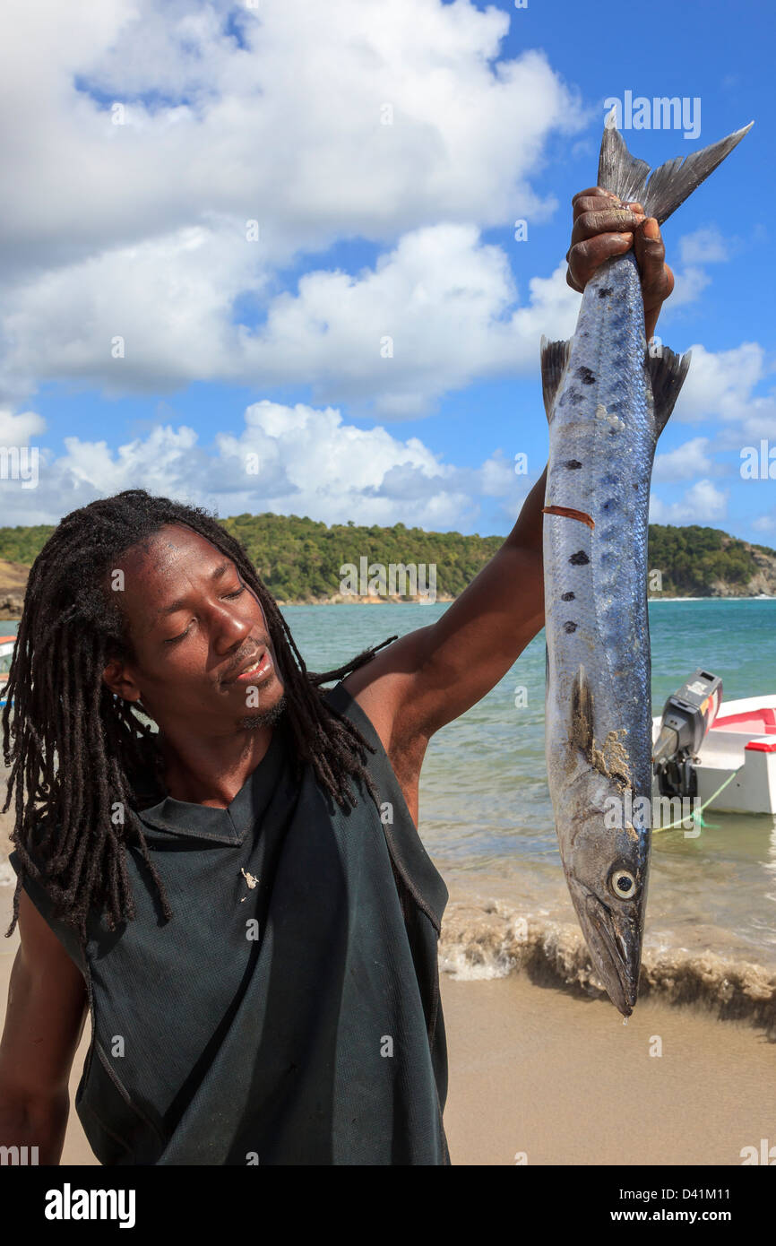 Local fisherman with fish from a fresh catch at Savannes Bay, St Lucia - Stock Image