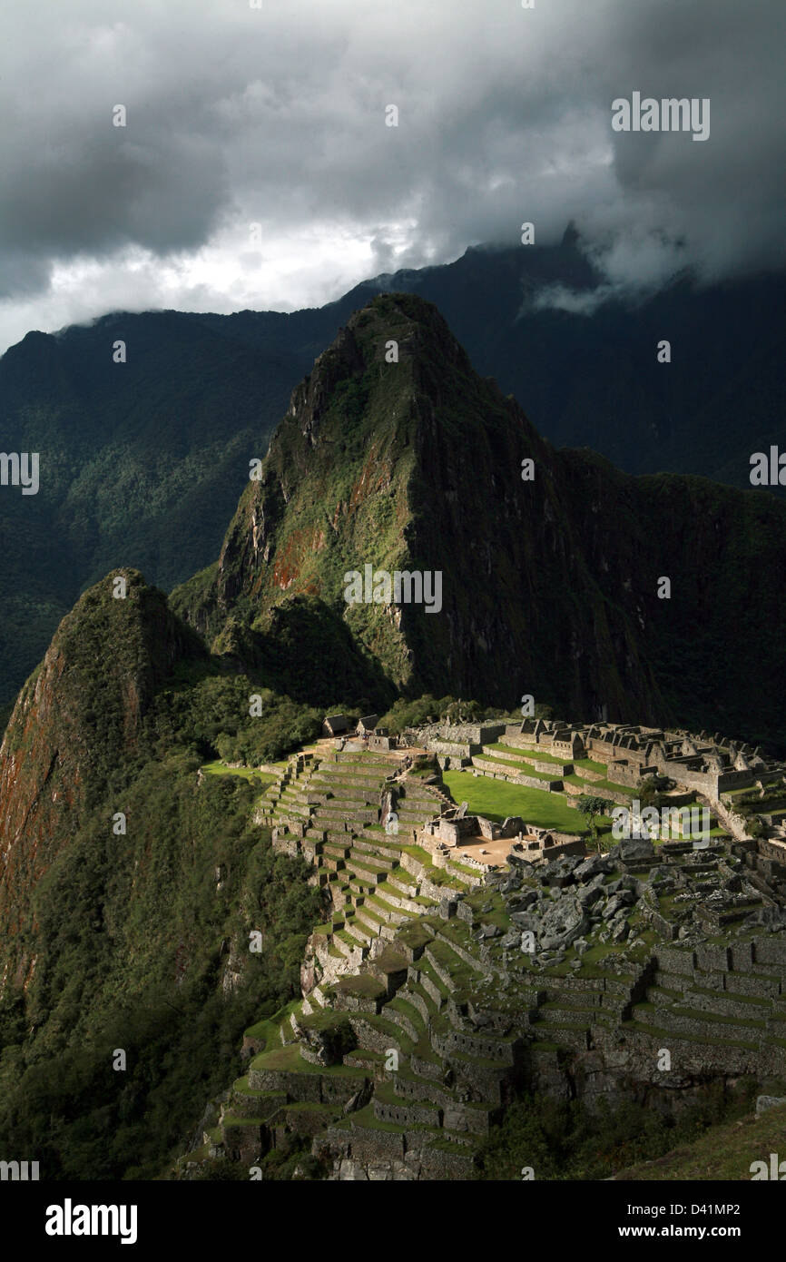 View above the Machu Picchu with Huayna Picchu mountain in the background - Stock Image