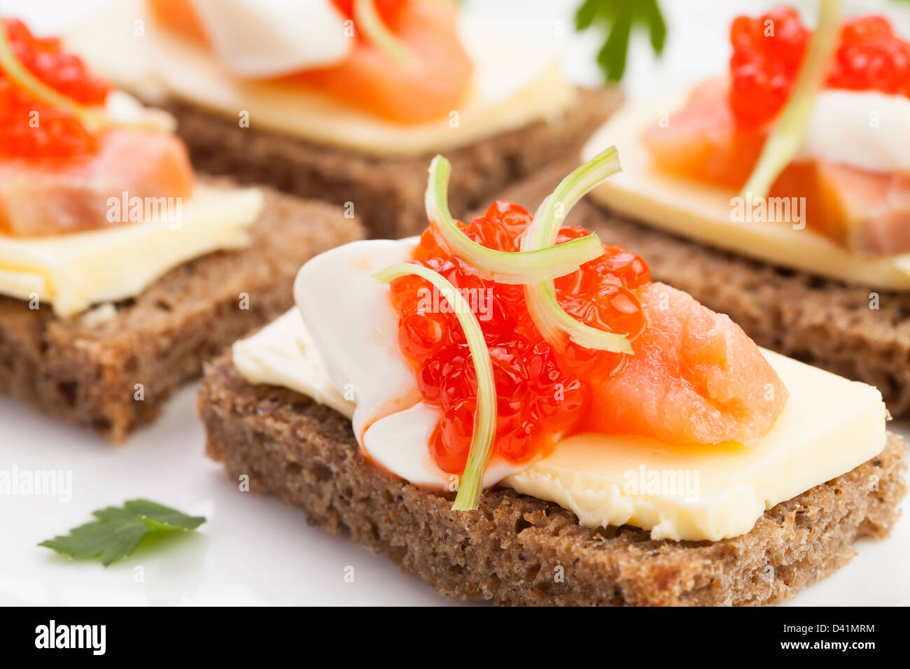 caviar salmon sandwiches on white - Stock Image