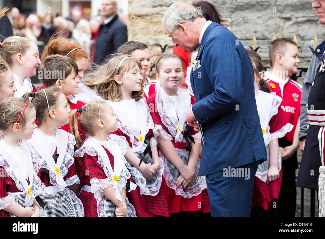 Prince charles greets children in welsh national dress on st Davids day in Cardiff. Stock Photo
