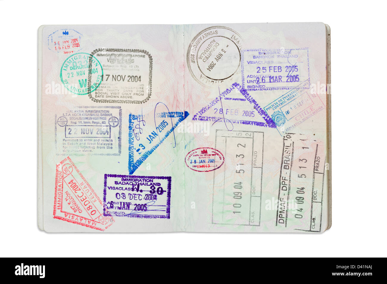 Inside Of A Well Travelled UK Passport Isolated Against White With Clipping Path