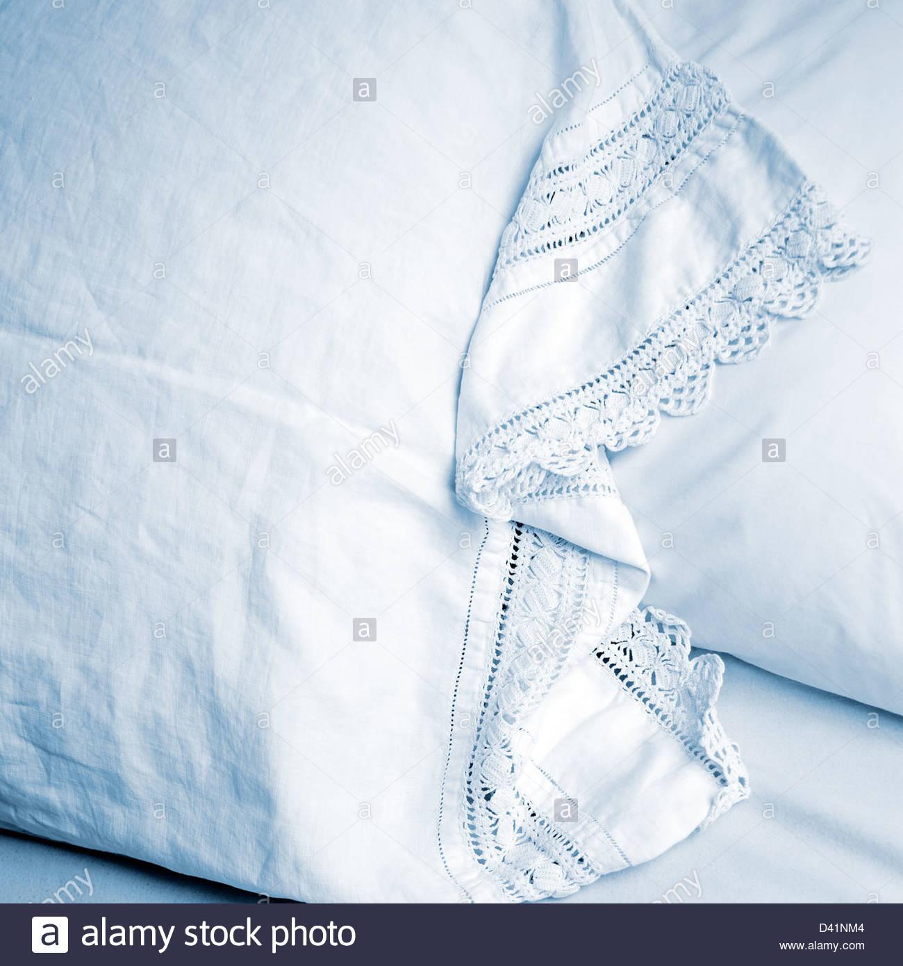 Antique linen pillow cases, lace edge - Stock Image
