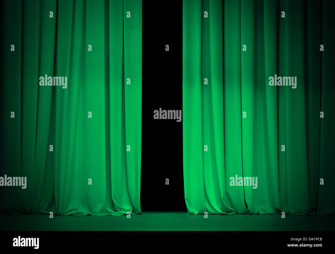 green or emerald curtain on theater or cinema stage slightly open - Stock Image