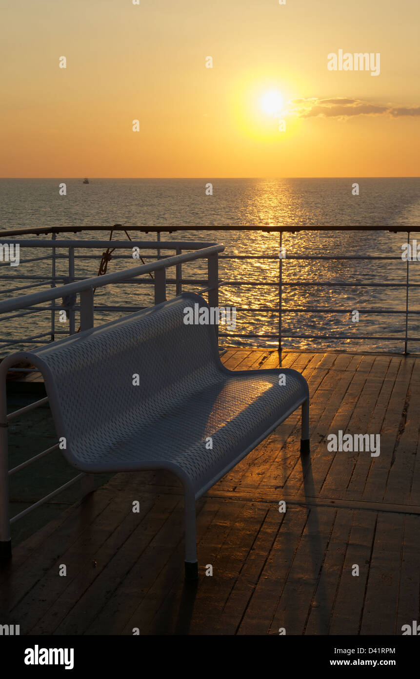 Sunset from the decks of a ferry in the English Channel - Stock Image