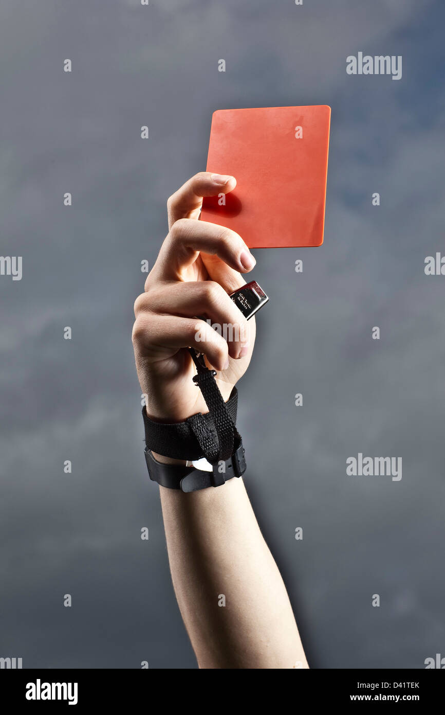 Referee holding red card football - Stock Image