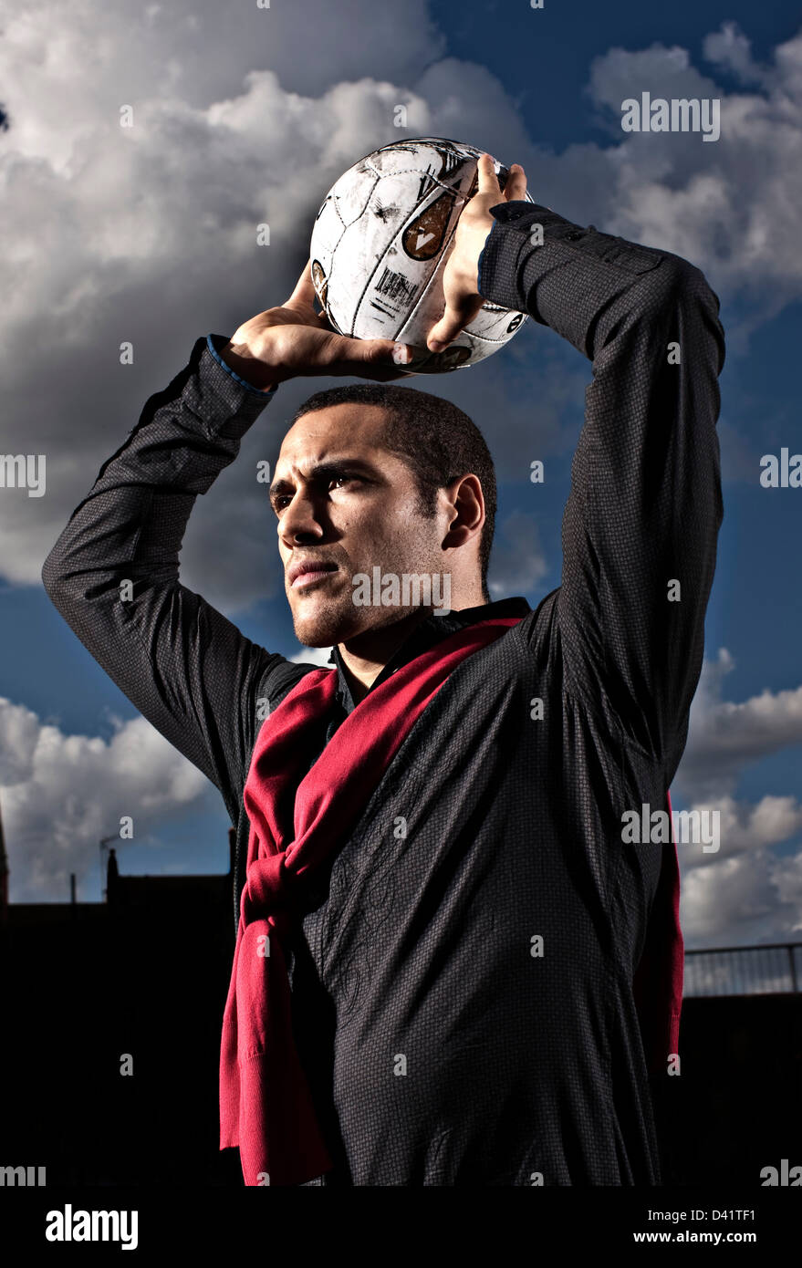 Footballer throwing ball in - Stock Image