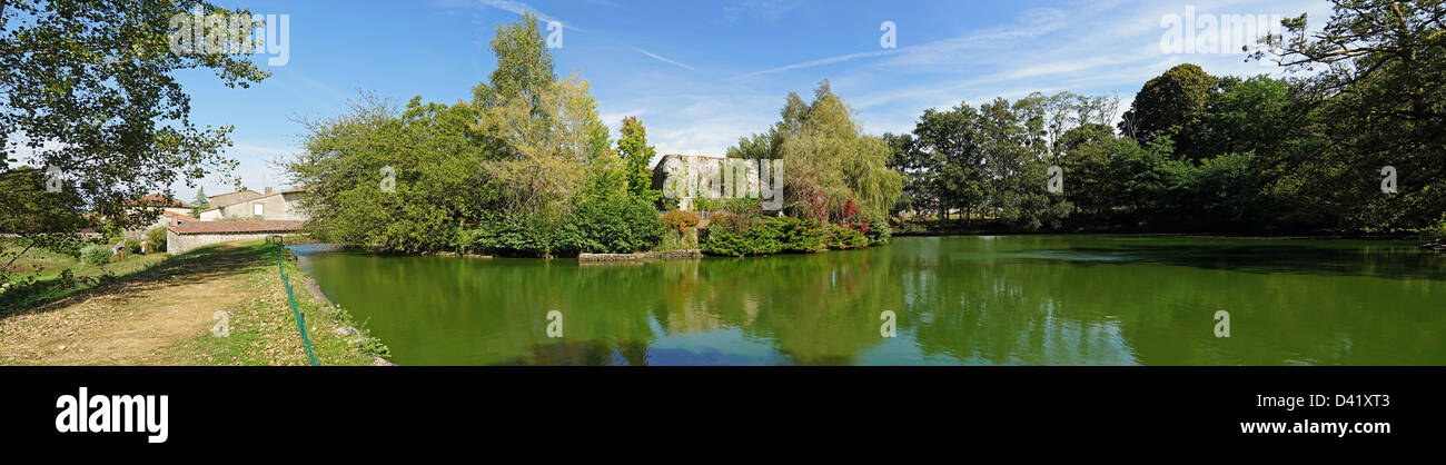 Panoramic view of the castle pond of Mortemart, Limousin, France - Stock Image