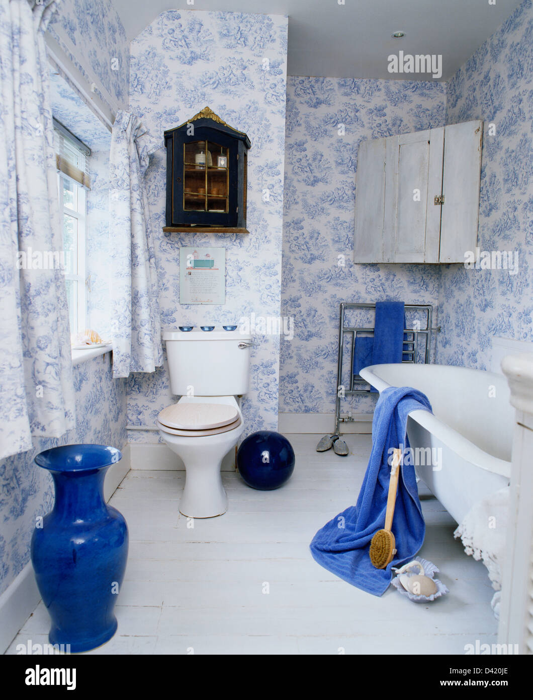 Tall Blue Vase In Country Bathroom With Blue White Toile
