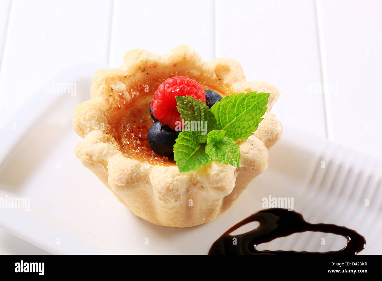 Mini tartlet shell filled with Creme brulee - Stock Image