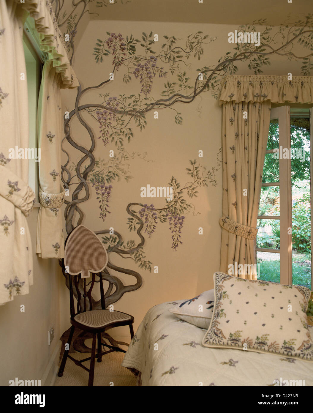 small chair in corner of cottage bedroom with hand painted wisteria