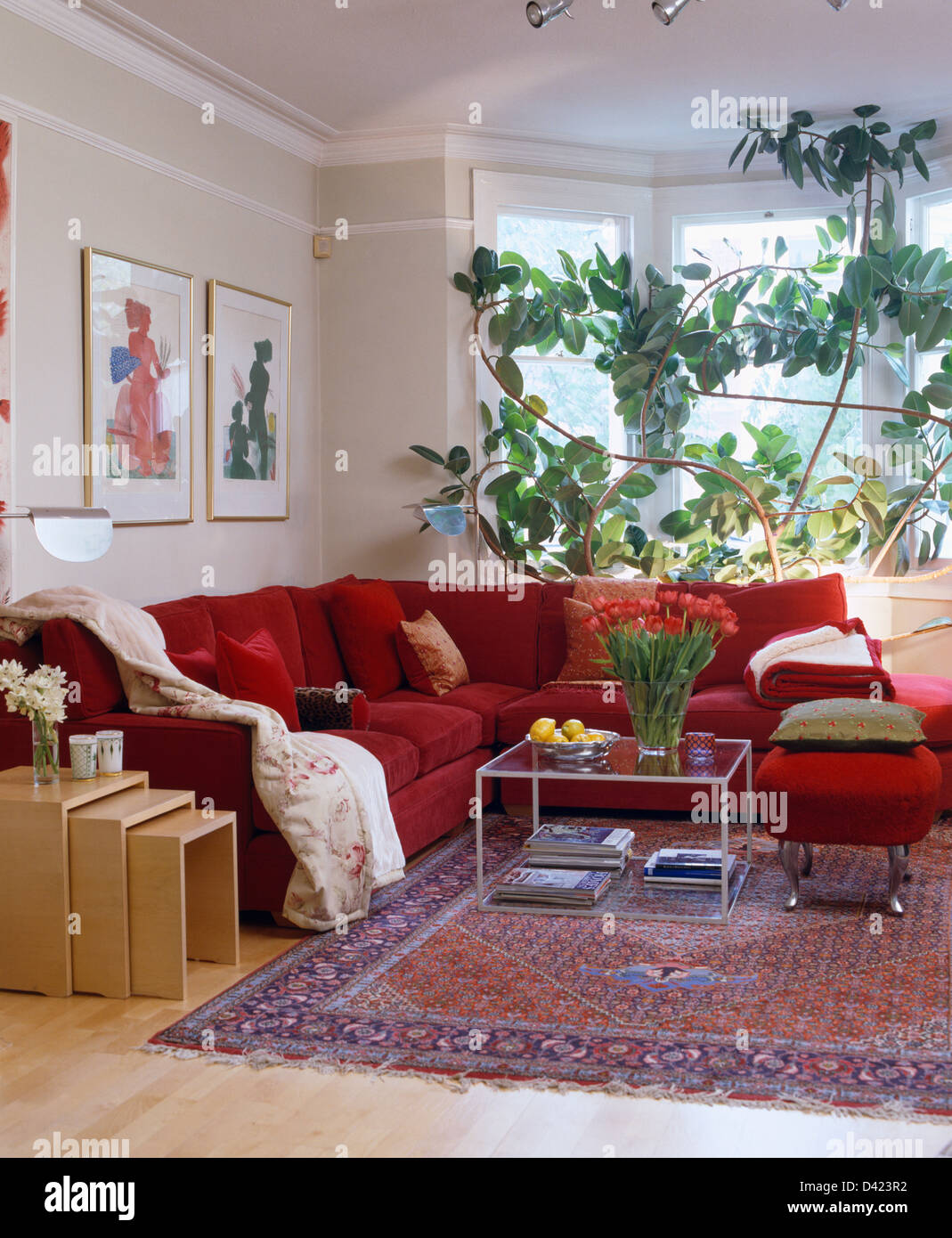 Beech nest of tables beside l shaped red sofa in modern living room beech nest of tables beside l shaped red sofa in modern living room with perspex coffee table and oriental rug watchthetrailerfo