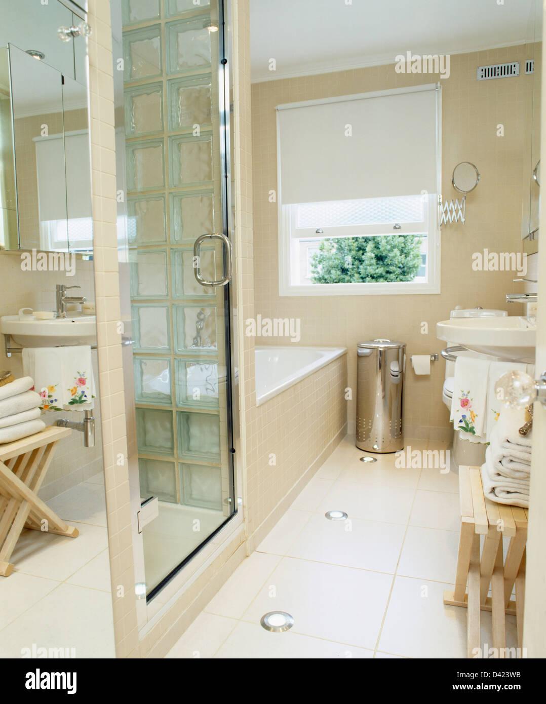 Glass door on shower cabinet in modern bathroom with recessed floor ...
