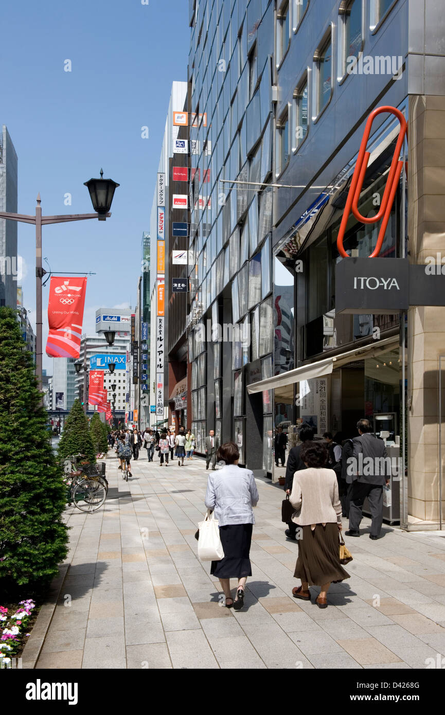 On a sunny afternoon shoppers walking along Chuo-dori (Main Street) in the upscale Ginza shopping district in downtown - Stock Image