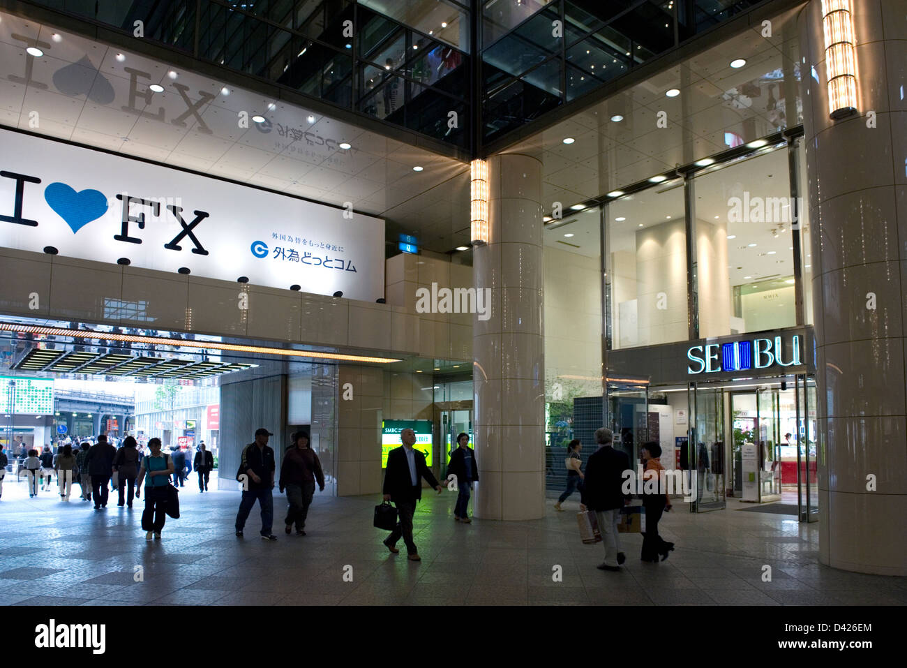 Pedestrians passing through the Yurakucho Marion Building in the Yurakucho district of downtown Tokyo. - Stock Image