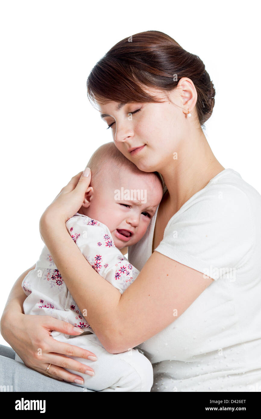 Mother trying to comfort her crying baby isolated - Stock Image