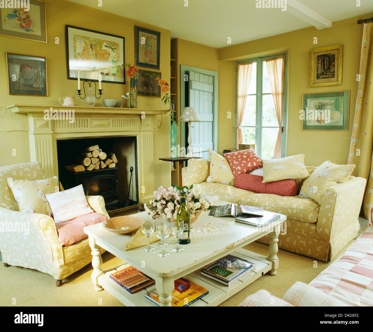 White Painted Coffee Table In Cosy Country Living Room With Armchair And  Sofa Covered In Cream Vanessa Arbuthnot Fabric