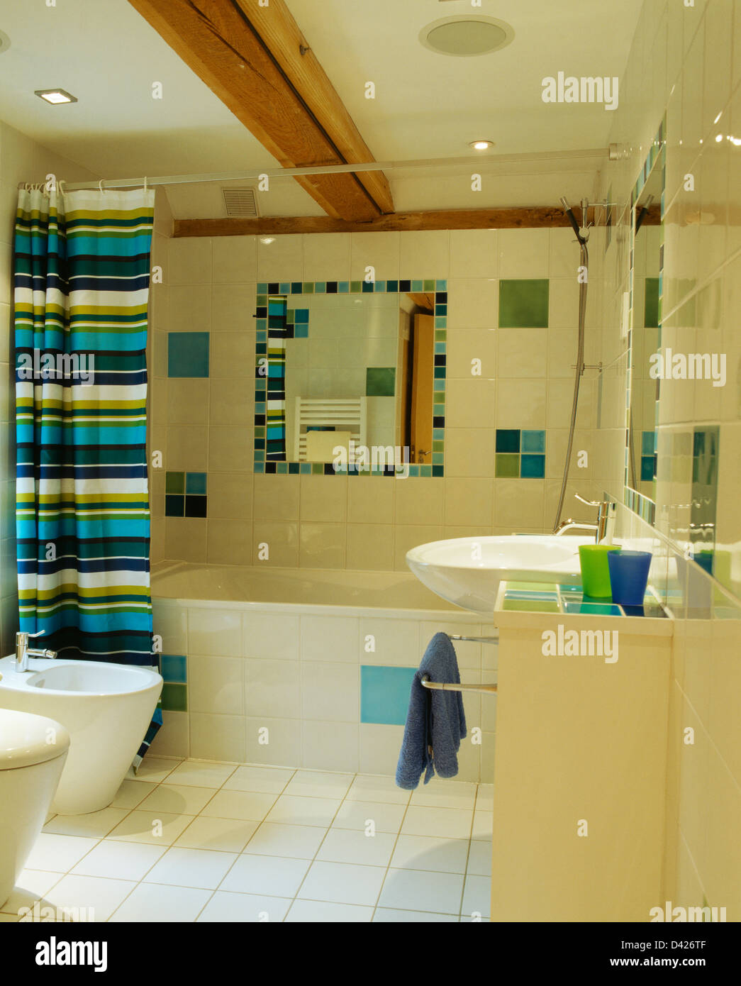 Brightly Striped Shower Curtain On Bath In Modern Bathroom With Tiled Mirror And Colorful Insets Cream Walls