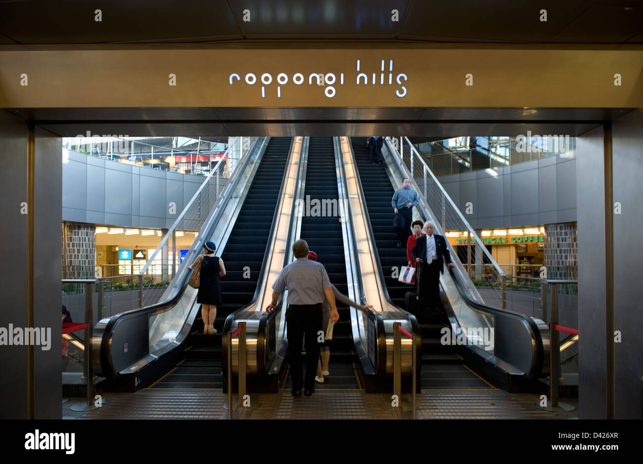 Escalator leading from subway up to plaza at upscale Roppongi Hills residential and shopping complex in downtown - Stock Image