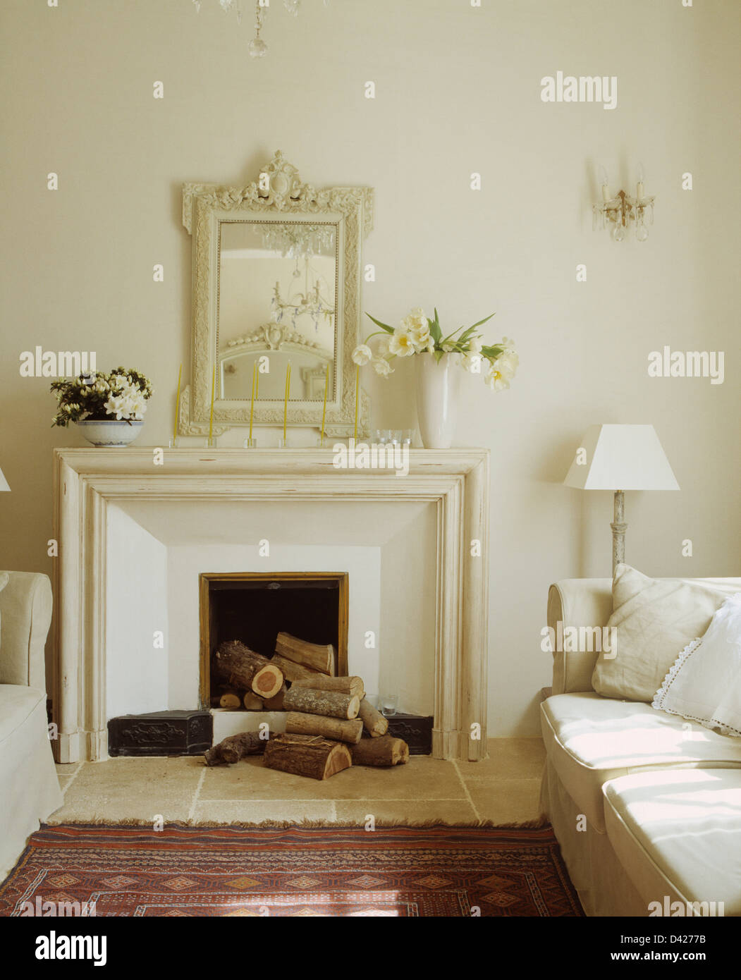 White Painted Craved Mirror Above Simple Fireplace With Logs In White  French Country Living Room With White Sofas