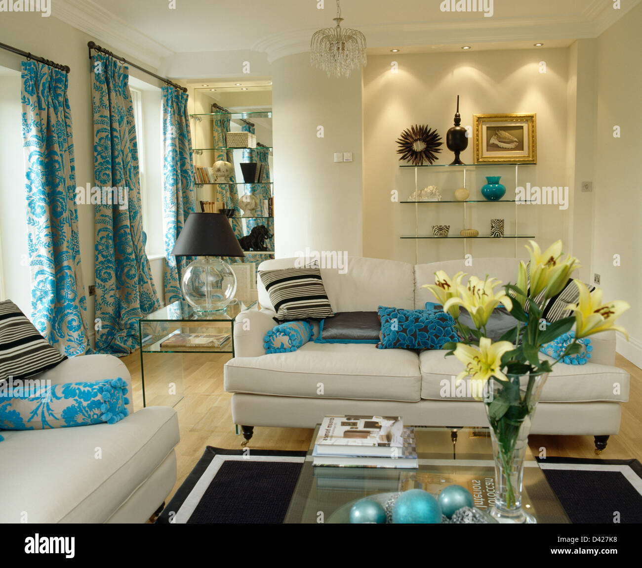 Recessed Lighting Above Alcove Shelving In Cream Living Room With Turquoise  Cushions On White Sofas