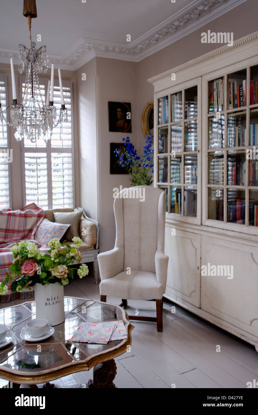 Flower Arrangement On Antique Table In Living Room With