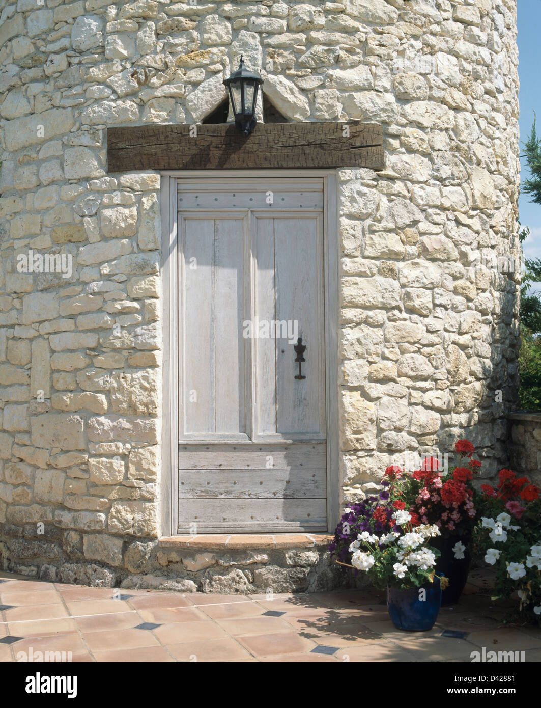 White Door In Stone Tower Of French Country House