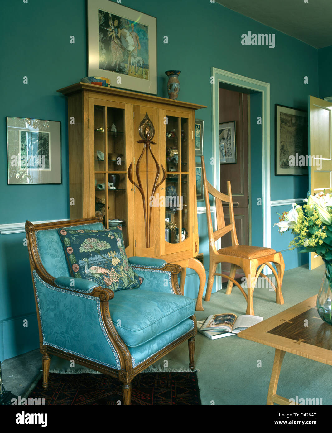 Turquoise Blue Damask Armchair And Pale Wood Glass Fronted Cabinet In  Turquoise Country Living Room